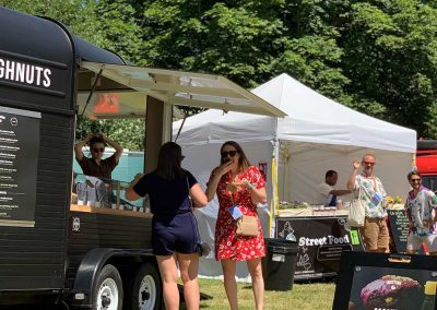 People enjoying Crosstown Doughnuts at a House Festival event