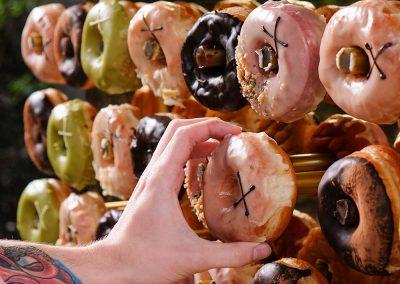 A variety of doughnuts on a doughnut wall