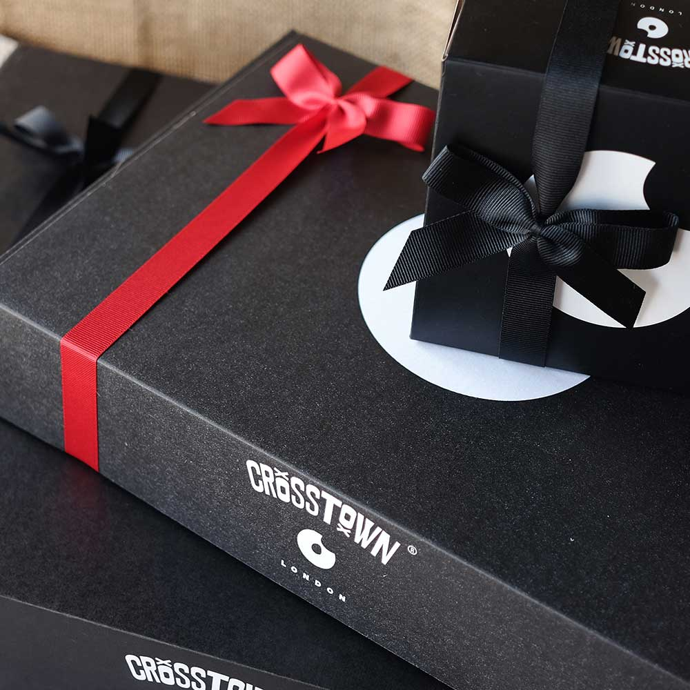 Black and white Crosstown delivery boxes